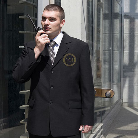 An SGI uniformed security guard patrols an office building.